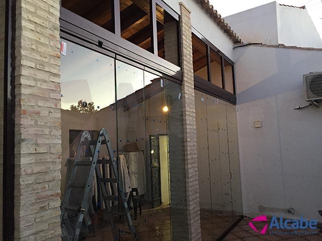 Cortina de cristal para cerramiento de patio en El Ronquillo, Sevilla