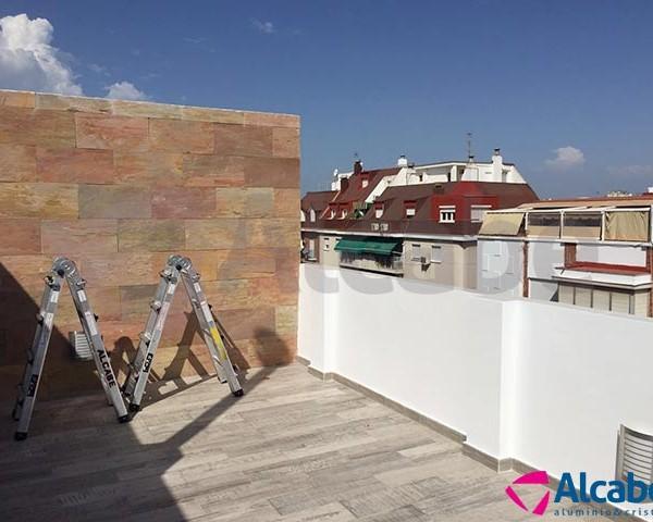 Cerramiento ático Huelva con cortina de cristal sin perfiles Sunflex SF-25