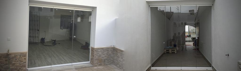 Cerramiento para patios interiores con cortinas de cristal
